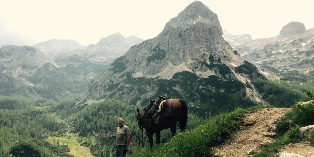 Leading a pack horse down, Triglav National Park, Slovenia