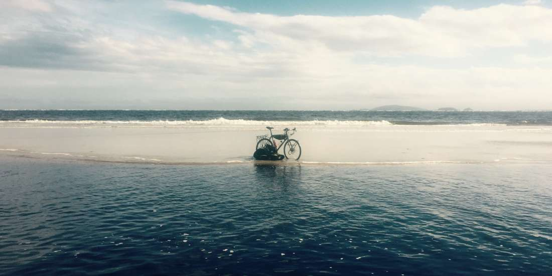 Lagoon and bike on beach near Superagui, Brazil